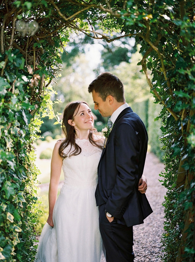 bride and groom at hilltop country house wedding